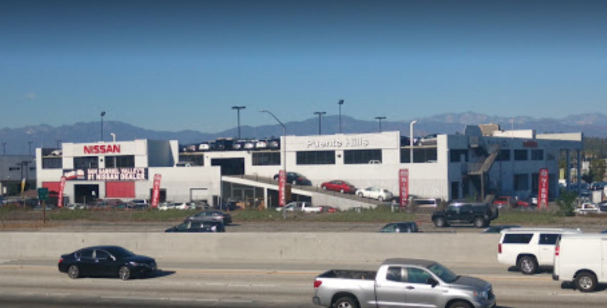 Freeway view of Nissan dealership
